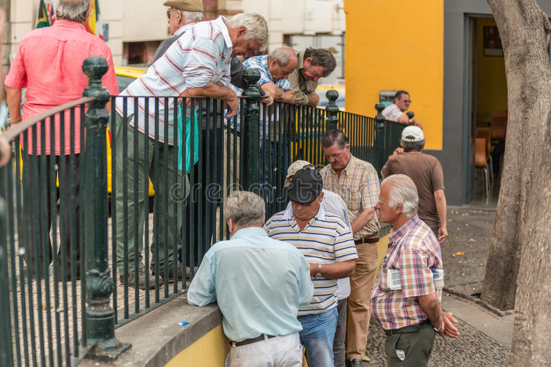 FUNCHAL, PORTUGAL - JUNE 27, 2015: Active retirement, old people and seniors free time, elderly men having fun and playing cards royalty free stock photos