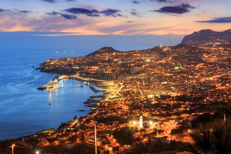 Funchal skyline after sunset in summer. Beautiful skyline cityscape aerial view from the hill of the city Funchal on the island Madeira at sunset in summer royalty free stock images