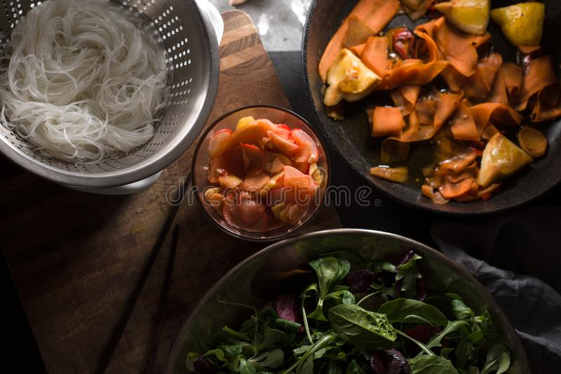 Funchos and pickled carrots, ginger and lettuce close-up. Asian cuisine. Horizontal stock photography
