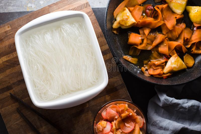 Funchoza and pickled carrots, ginger. Asian cuisine. Horizontal stock image