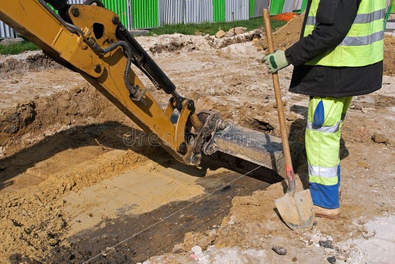 Funcionamento da escavadora fotografia de stock