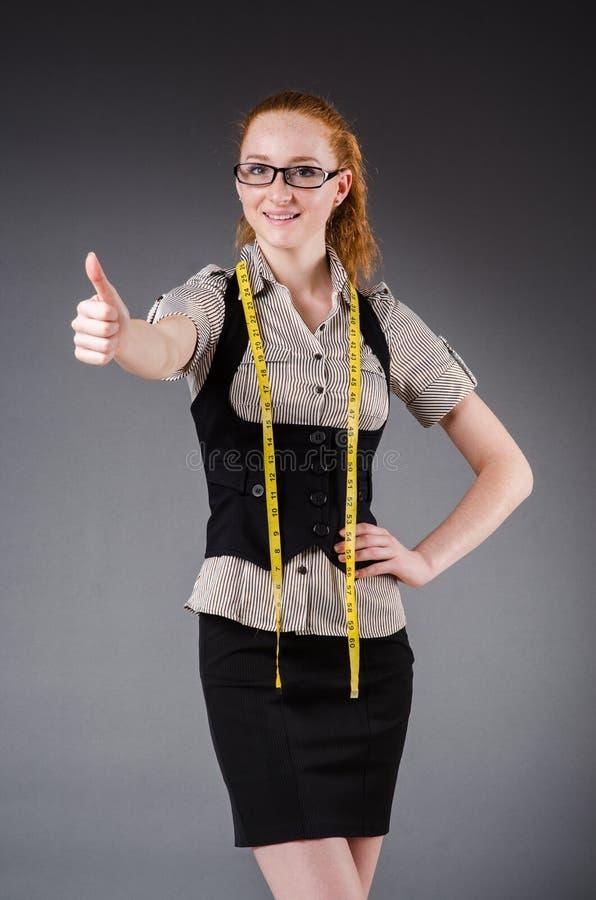 Funcionamento do alfaiate da mulher fotos de stock