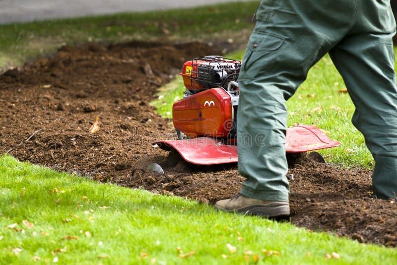 Funcionamento do jardineiro fotografia de stock royalty free