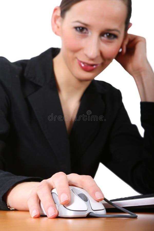 Funcionamiento de la mujer de negocios   foto de archivo libre de regalías
