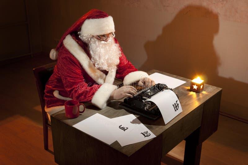 Funcionamiento de Papá Noel fotos de archivo libres de regalías