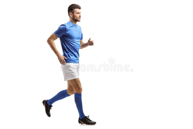Funcionamiento del jugador de fútbol foto de archivo