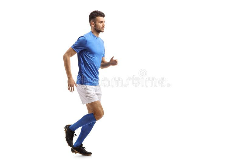 Funcionamiento del jugador de fútbol fotografía de archivo