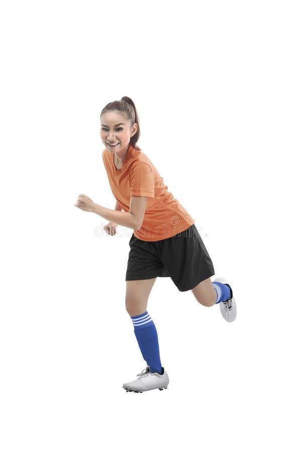 Funcionamiento femenino del jugador de fútbol imagenes de archivo