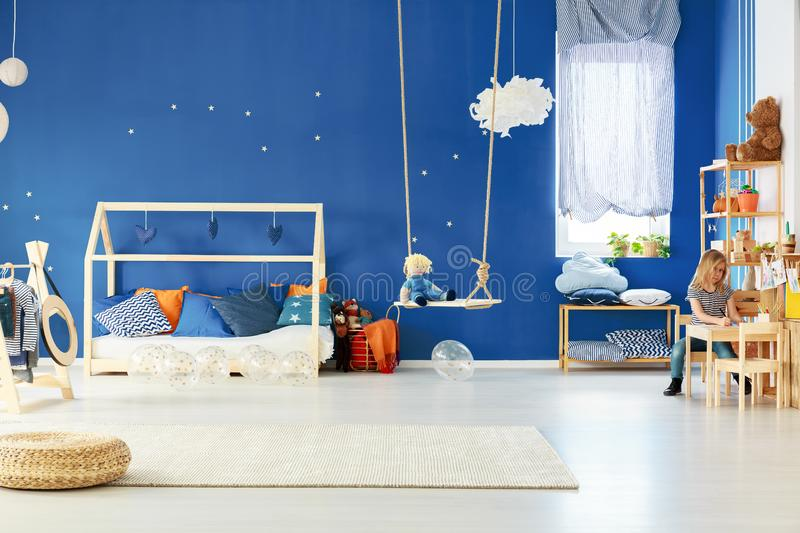 Functional child room with swing stock photos