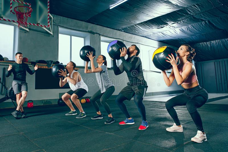 Functional fitness workout at the gym with medicine ball stock images