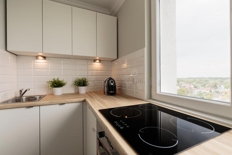 Functional kitchen in new flat stock photos
