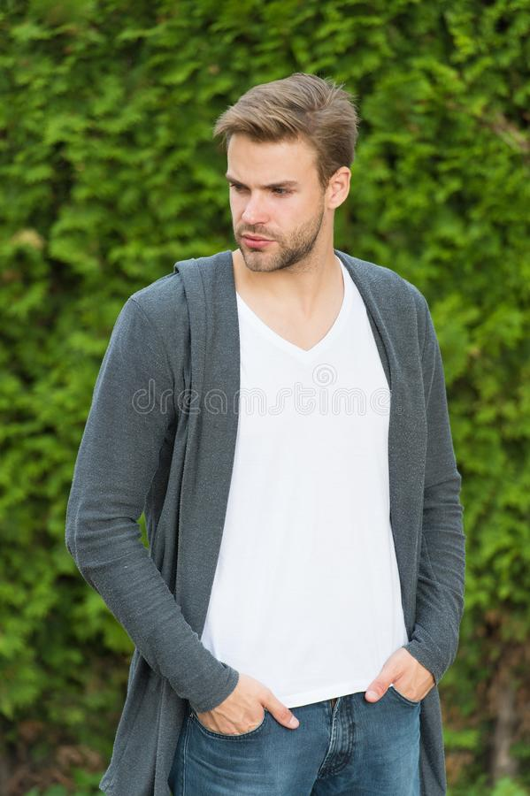 Fundamentals of good dressing. Handsome man unshaven face and stylish blond hair. Handsome caucasian man nature green royalty free stock images