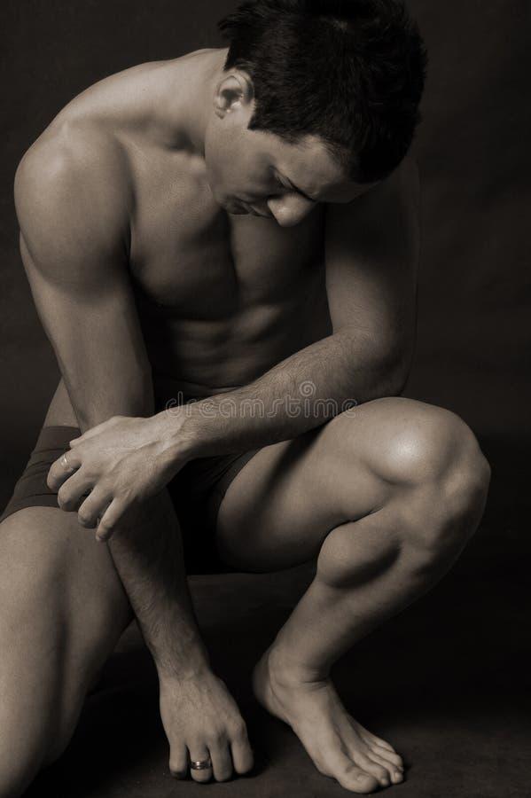 fundersam manlig arkivfoto