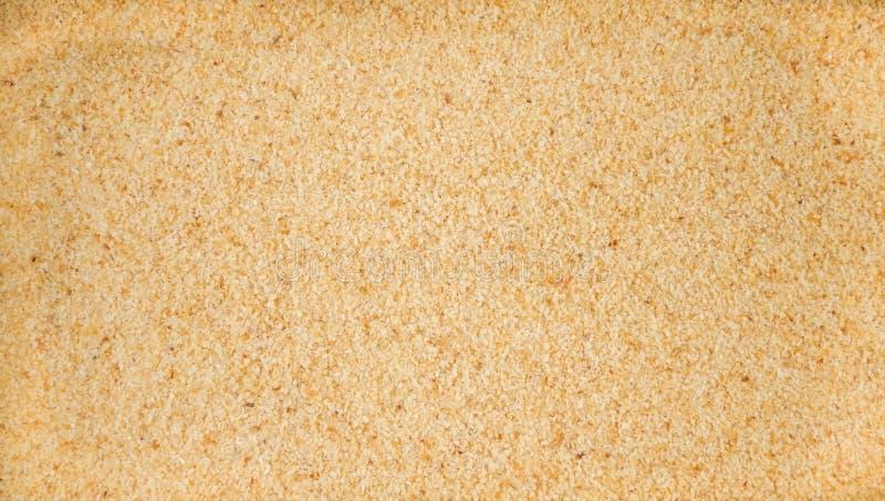 Fundo à terra moído secado do alho Textura de tempero natural Especiarias e ingredientes de alimento naturais imagens de stock royalty free