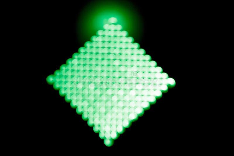 Fundo abstrato, bokeh verde em um romboidal preto O fulgor de cima de imagem de stock royalty free