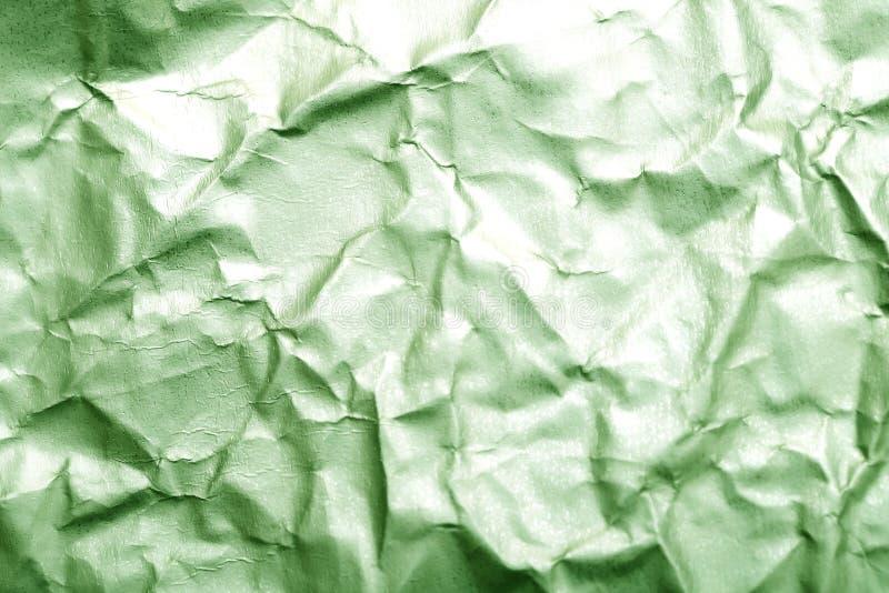 Fundo abstrato borrado da superfície de papel verde amarrotada imagem de stock royalty free