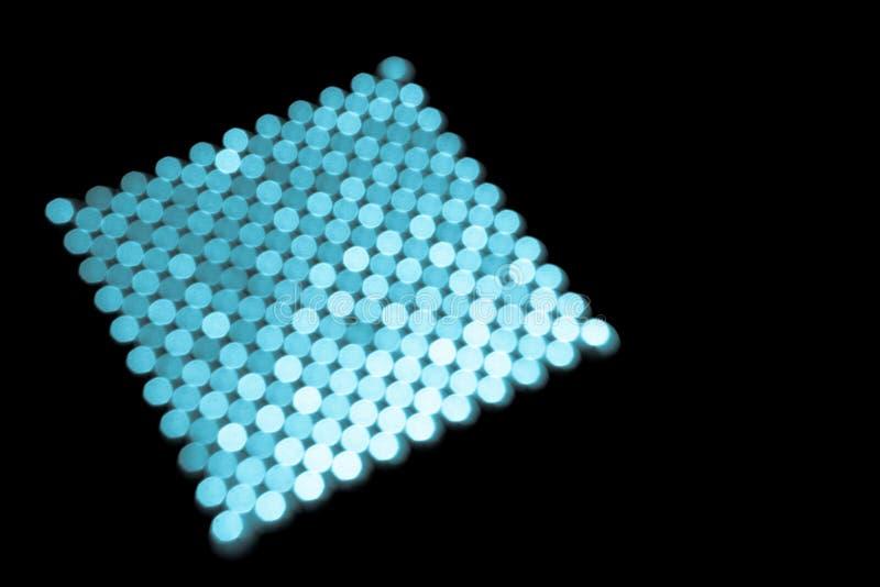 Fundo abstrato, círculos azuis em um quadrado no preto imagem de stock royalty free