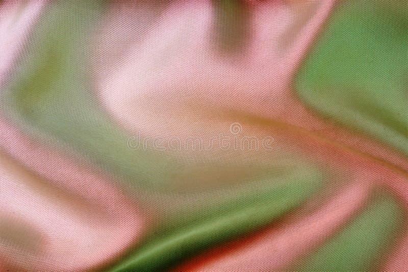 Fundo abstrato colorido da malha A textura das dobras do tecido forma um padrão natural único, aplicável ao imagem de stock royalty free