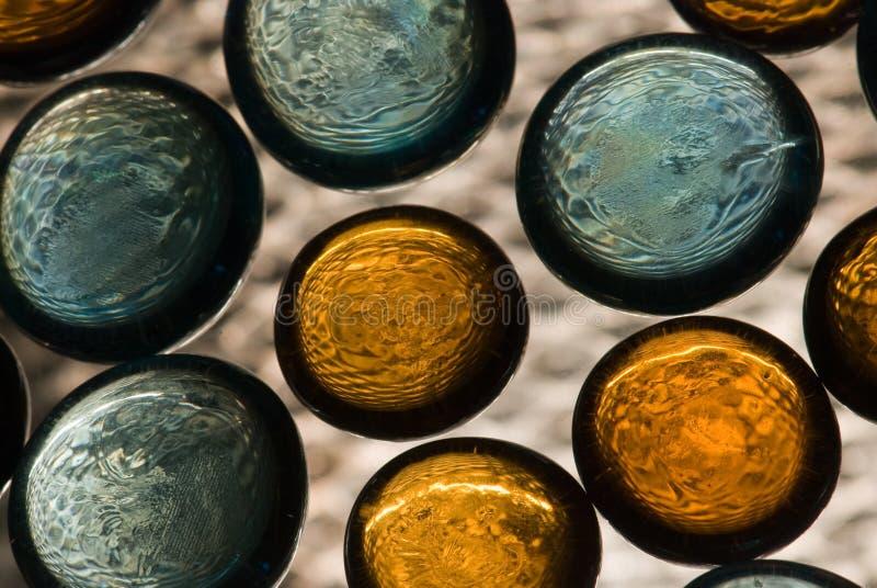 Fundo abstrato com círculos alaranjados e azuis fotografia de stock royalty free