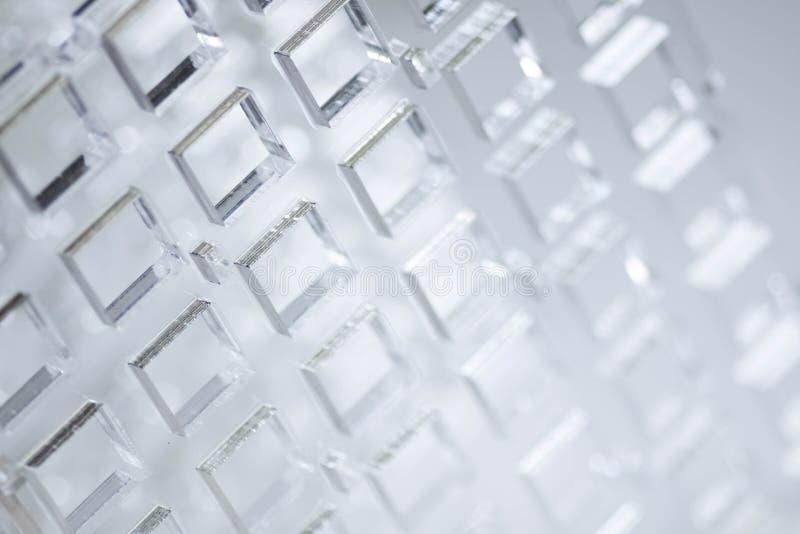 Fundo abstrato da alto-tecnologia Uma folha do plástico ou do vidro transparente com os furos cortados Corte do laser de foto de stock royalty free