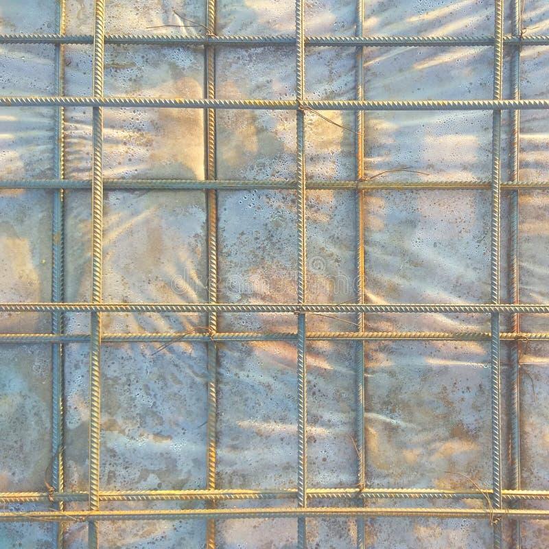 Fundo abstrato da armadura do ferro pronto para a armadura concreting do metal no close-up concretas reforçado das estruturas fotos de stock royalty free