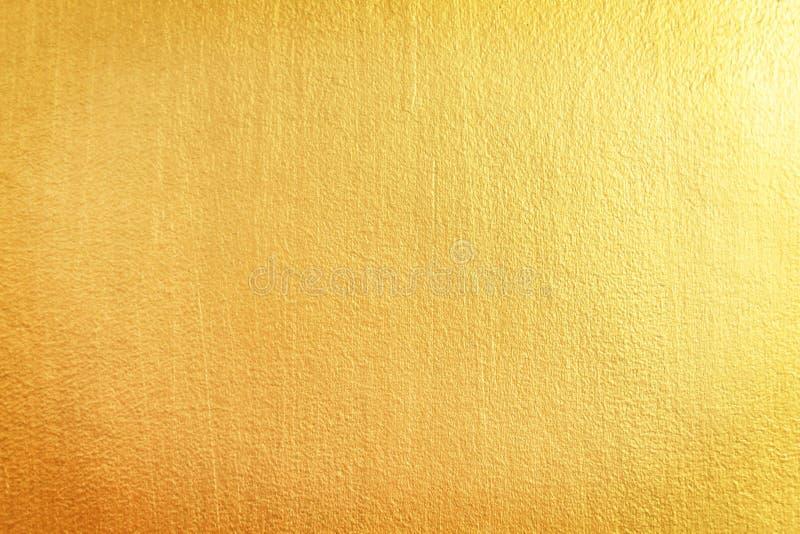 Fundo abstrato da textura dos testes padrões do muro de cimento do ouro fotografia de stock royalty free