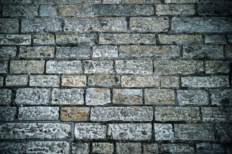 Fundo abstrato do pavimento velho da pedra Tijolo de pedra cinzento que pavimenta a textura Feche acima da estrada antiga Passeio foto de stock royalty free