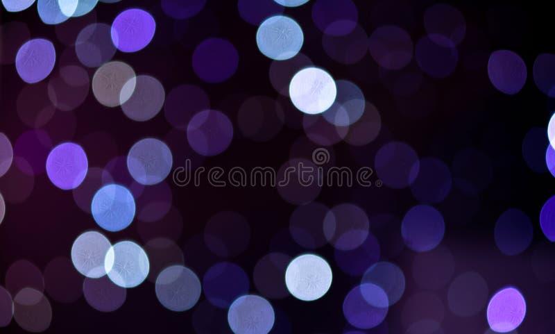 Fundo abstrato festivo dos feriados do Natal com luzes e as estrelas defocused do bokeh imagens de stock royalty free