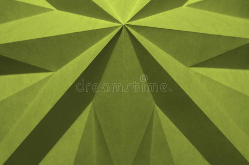 Fundo abstrato monocromático verde-amarelo do origâmi fotografia de stock