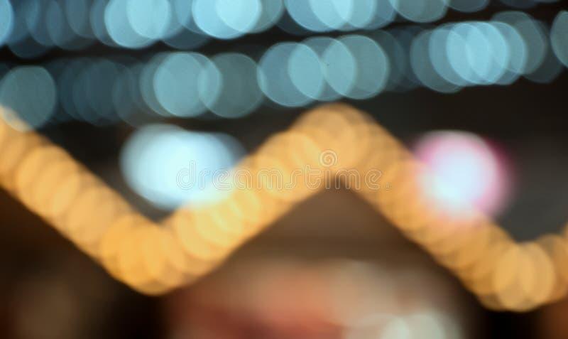 Fundo agradável do Natal com bokeh colorido da luz das festões, feriados, ano novo fotografia de stock royalty free