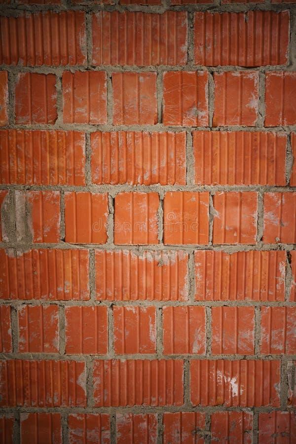 Fundo alaranjado novo do close up da parede de tijolo imagem de stock royalty free