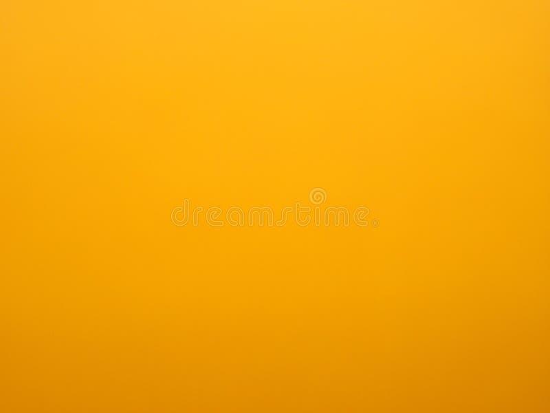 Fundo amarelo borrado da superfície do papel fotografia de stock royalty free