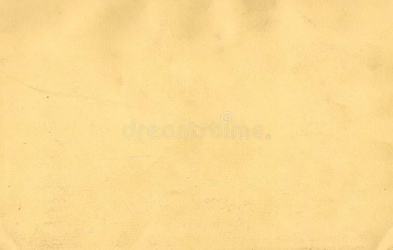 Fundo amarelo da superfície do papel imagens de stock royalty free