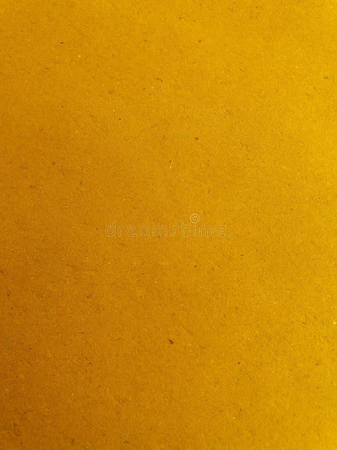Fundo amarelo da superfície do papel fotografia de stock royalty free
