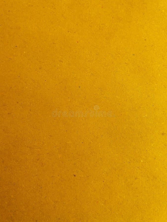 Fundo amarelo da superfície do papel imagem de stock royalty free