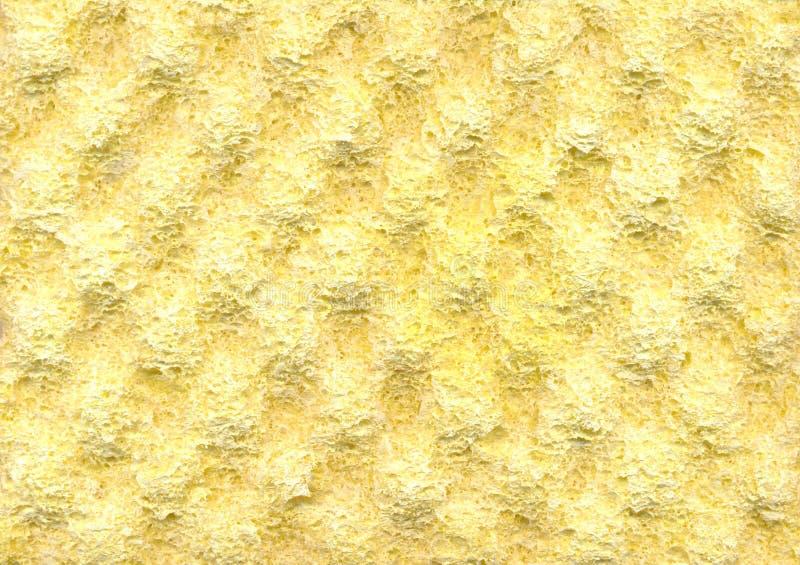 Fundo amarelo da textura da borracha de espuma fotografia de stock royalty free