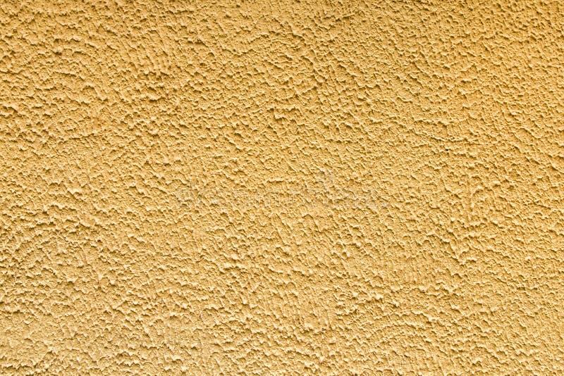 Fundo amarelo da textura da parede do emplastro foto de stock royalty free