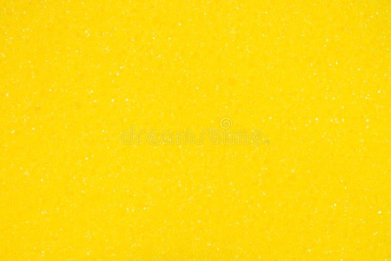 Fundo amarelo da textura do close-up da esponja imagens de stock royalty free