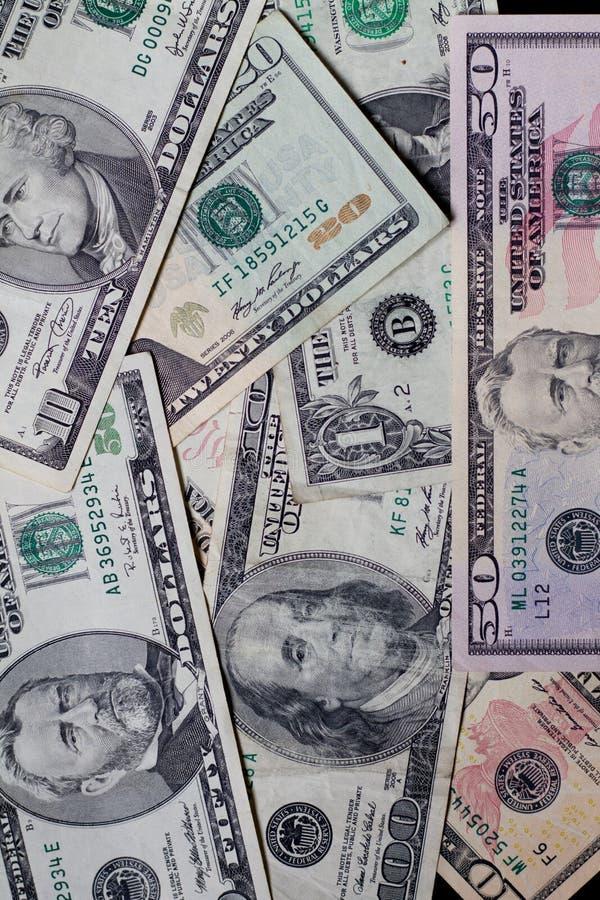 Fundo americano do dinheiro das notas de dólar da moeda dos E.U. fotografia de stock
