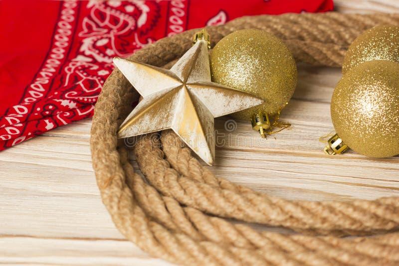 Fundo americano do Natal com laço do vaqueiro e Natal de imagens de stock
