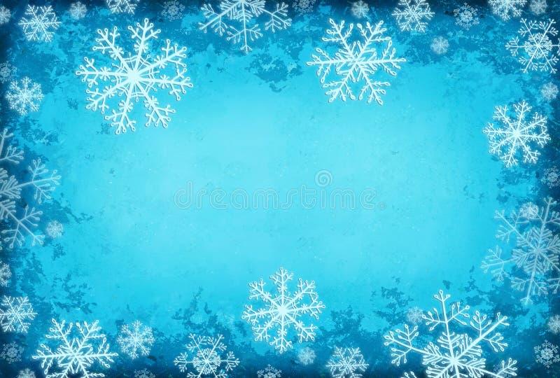 Fundo azul com flocos de neve foto de stock