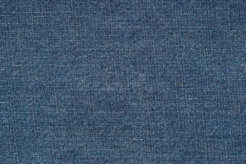 Fundo azul das calças de brim da sarja de Nimes fotografia de stock