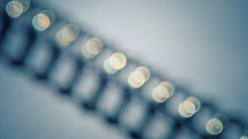 Fundo azul do tom de Bokeh, obscuro e granulado com filtro do vintage foto de stock royalty free