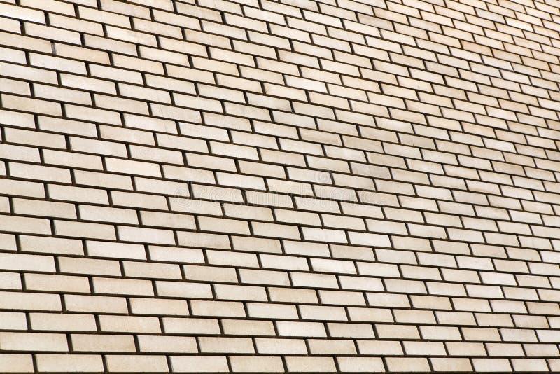 Fundo bege da parede de tijolo imagens de stock royalty free
