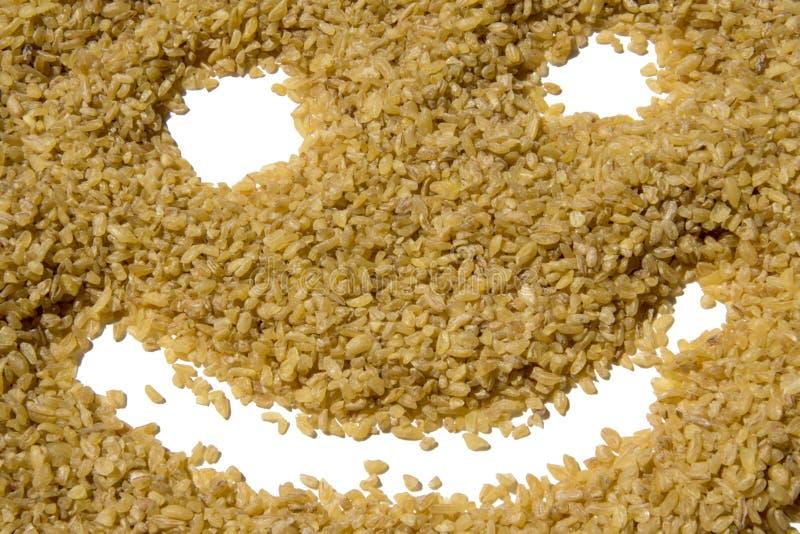 Fundo bonito da cara feliz da semente do Bulgur bio imagem de stock