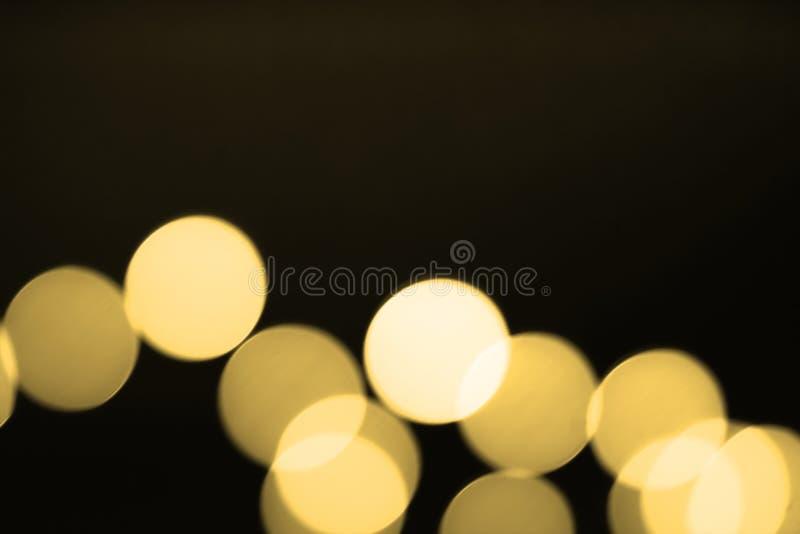 Fundo borrado abstrato das luzes do bokeh do ouro Luz Defocused do brilho fotos de stock royalty free