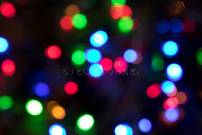 Fundo borrado de luzes de Natal ardentes Natal e Ne fotografia de stock