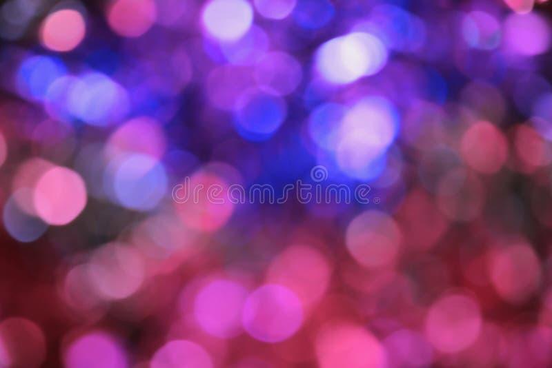 Fundo borrado sumário do bokeh Luzes azuis e cor-de-rosa imagem de stock royalty free