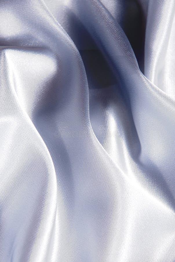 Fundo branco do cetim imagem de stock