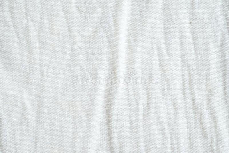Fundo branco enrugado da textura do tecido de algodão, papel de parede imagens de stock